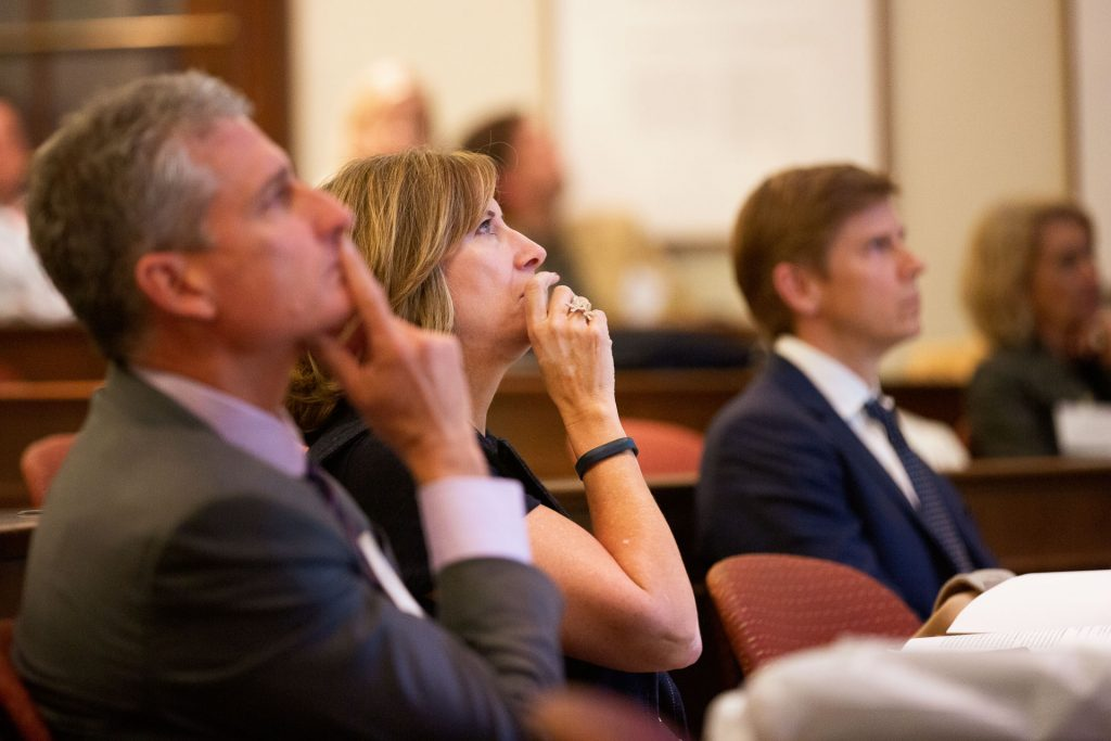 Judges listen to students delivering their presentation at the Dyer Center's Real Estate Competition.