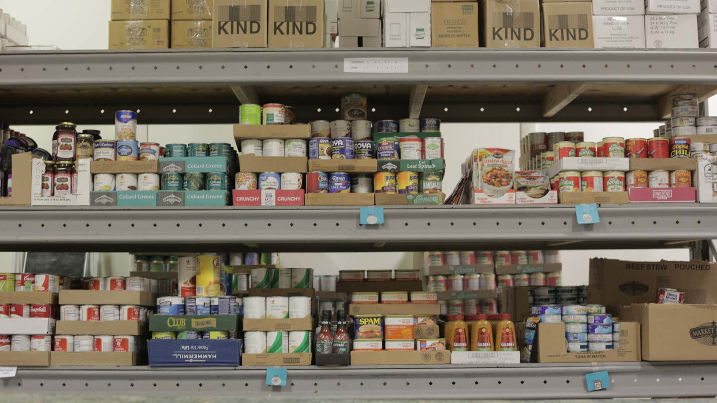 Shelves of canned and packaged goods at a food pantry