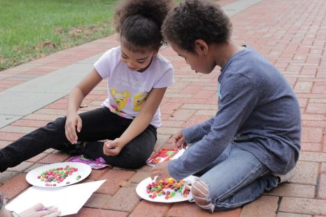 Two Cheston Elementary School third-grader learn math by using Skittles during a Center for Community Engagement program hosted by Lafayette College.