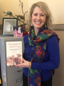 Lafayette College English Professor Carrie Rohman holds a copy of her book, Choreographies of the Living