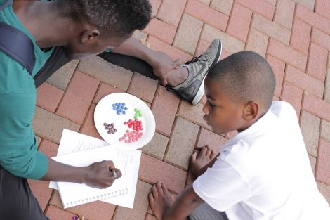 A Lafayette College student and Cheston Elementary School third-grader learn math by using Skittles during a Center for Community Engagement program.