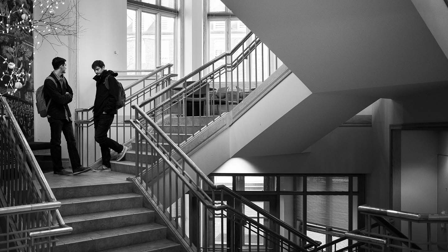 Students walking on stairs in Farinon.