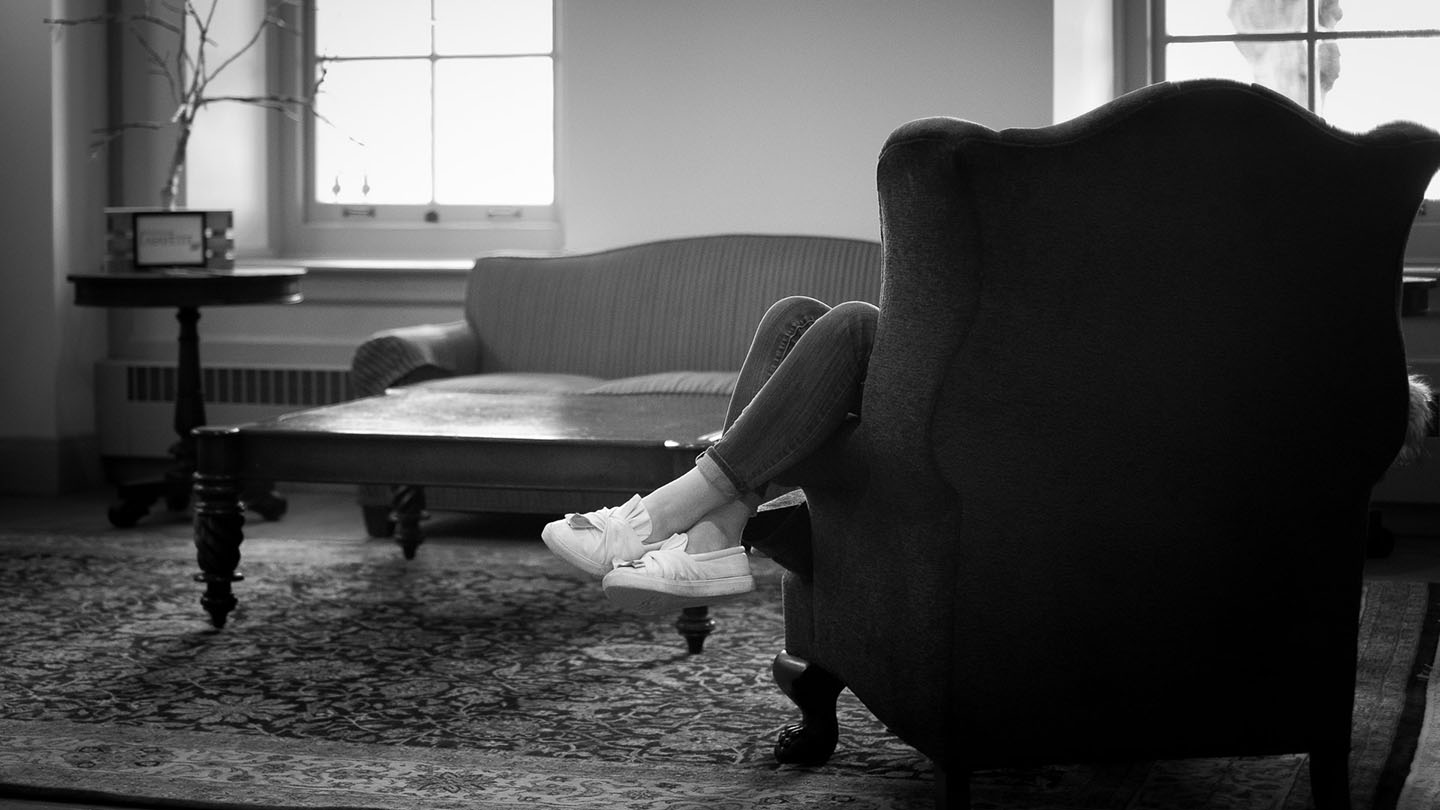 A student studies with her feet up.