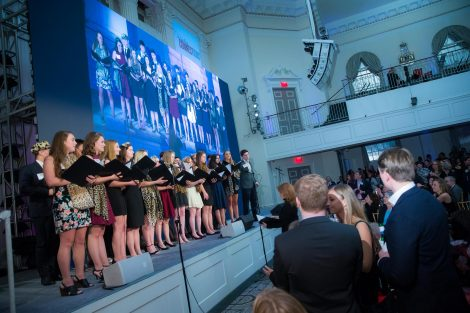 Chamber Singers students sing at the annual holiday party in New York City.