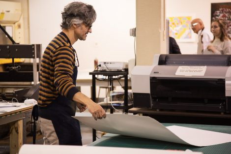 Pedro Barbeito, director of Lafayette College's Experimental Printmaking Institute, grabs paper