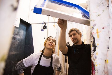 Two artists work at Lafayette College's Experimental Printmaking Institute.