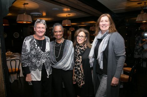 Four women pose for a photo at the First Women of Lafayette brunch in New York on Dec. 1.