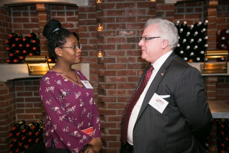 Two people talk at the First Women of Lafayette brunch in New York on Dec. 1.