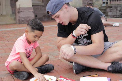 A Lafayette College student teaches a Cheston Elementary School third-grader math using Skittles.