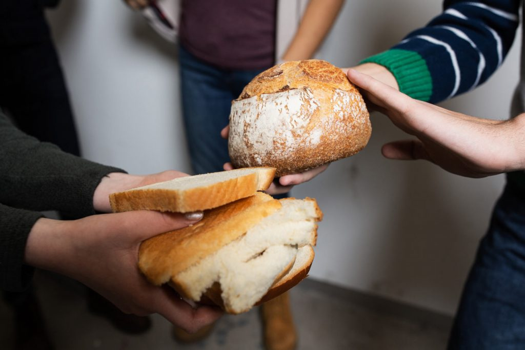 Hands holding homemade bread