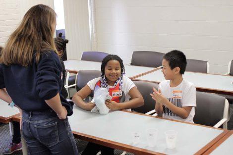 Students shake their bag.