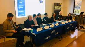 John Kincaid sits at a presentation table with other scholars at the international conference, Federalism, Democracy and National Diversity in the 21st Century: Challenges and Opportunities, hosted by University of Quebec.