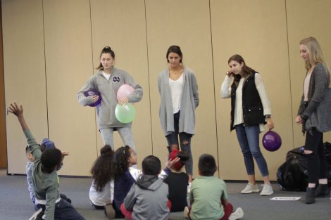 Lafayette students explain how to work together to keep balloons in the air.