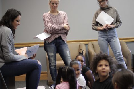 Elementary students laugh and react to Lafayette students.