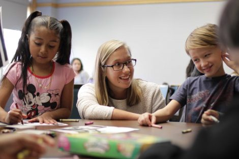 Lafayette student helps students color.