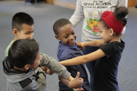 Elementary students work to untangle themselves.