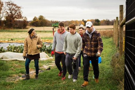 Lisa Miskelly, assistant director of food and farm, talks to members of Phi Psi fraternity helping with the building of a hoop house, a 22-by-21-foot structure that will help LaFarm extend its growing season earlier in spring and later in fall.