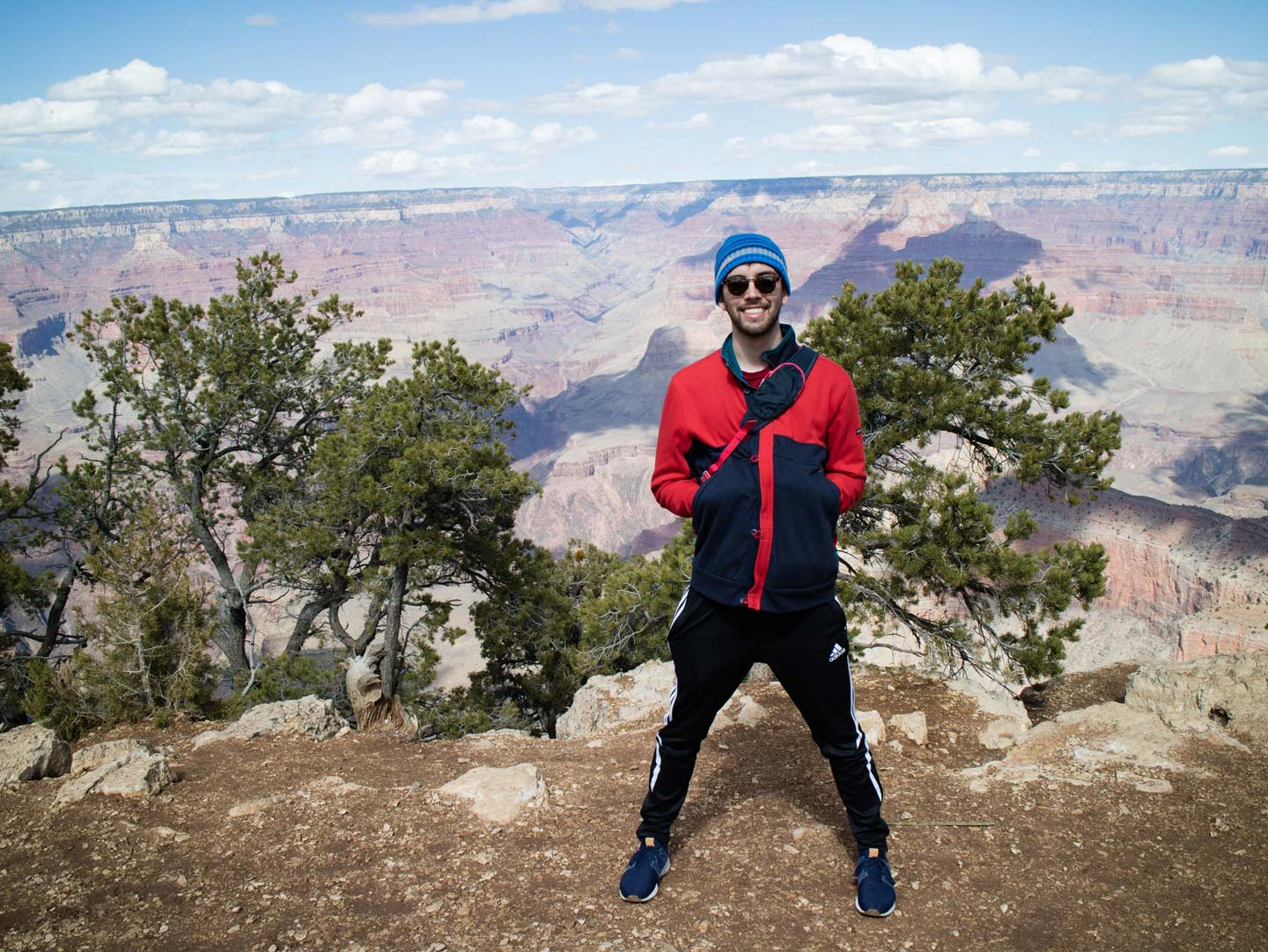 Robert Cuyjet '19 stands in front of a canyon.