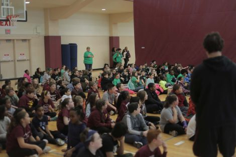 Fifth graders listen to Lafayette athletes.