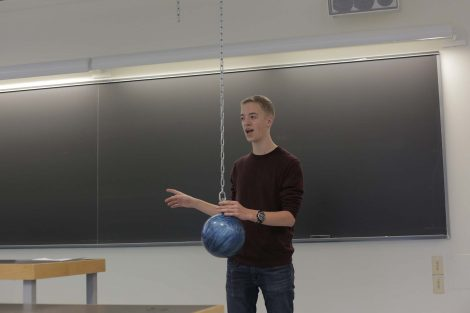Lafayette explains the bowling ball experiment.