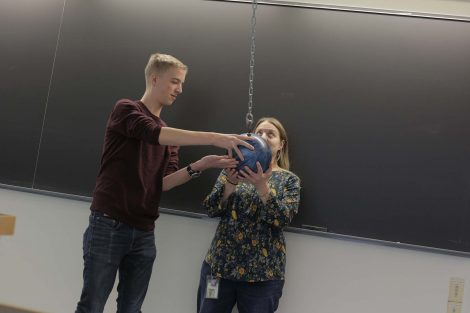 The ball is set in place in front of the teacher's face.