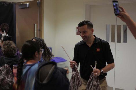 Wells Fargo employee hands out pom poms.