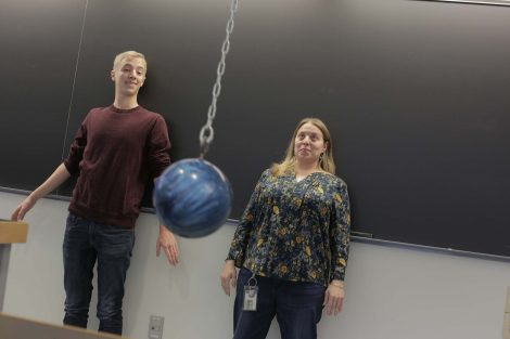 The ball is released, swing away from her face.