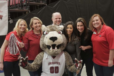 Wells Fargo team poses with the Leopard mascot.