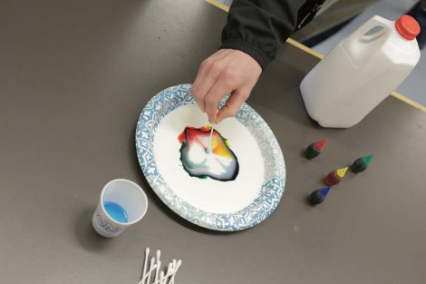 A cotton swab dipped in soap makes the food coloring spread across the milk in a cool pattern.