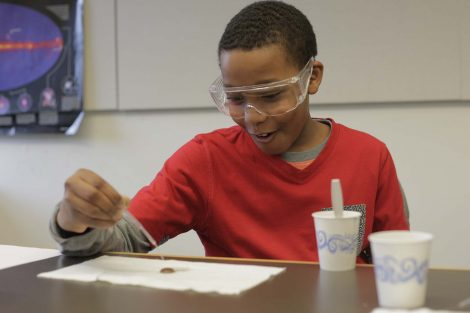 Fifth grader reacts to how many drips of water are on his penny.