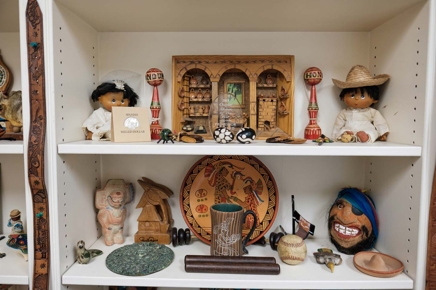 A collection of Spanish art in shelves