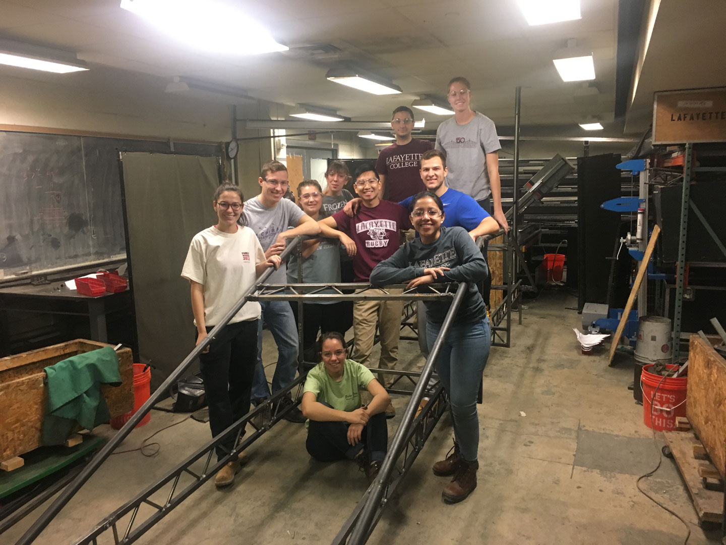 Mechanical engineering students pose by their model steel bridge.