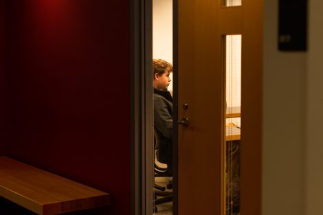 student sits in classroom hugel science center