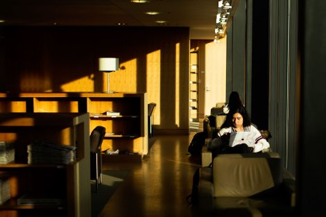 skillman library with student sitting and reading