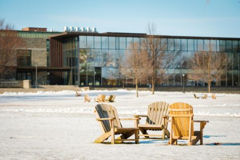 Adirondack chairs on the snow-covered Quad