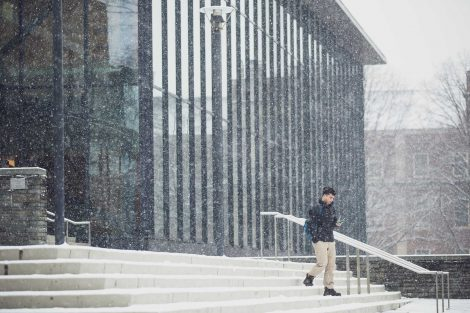 a student exits skillman in the snow