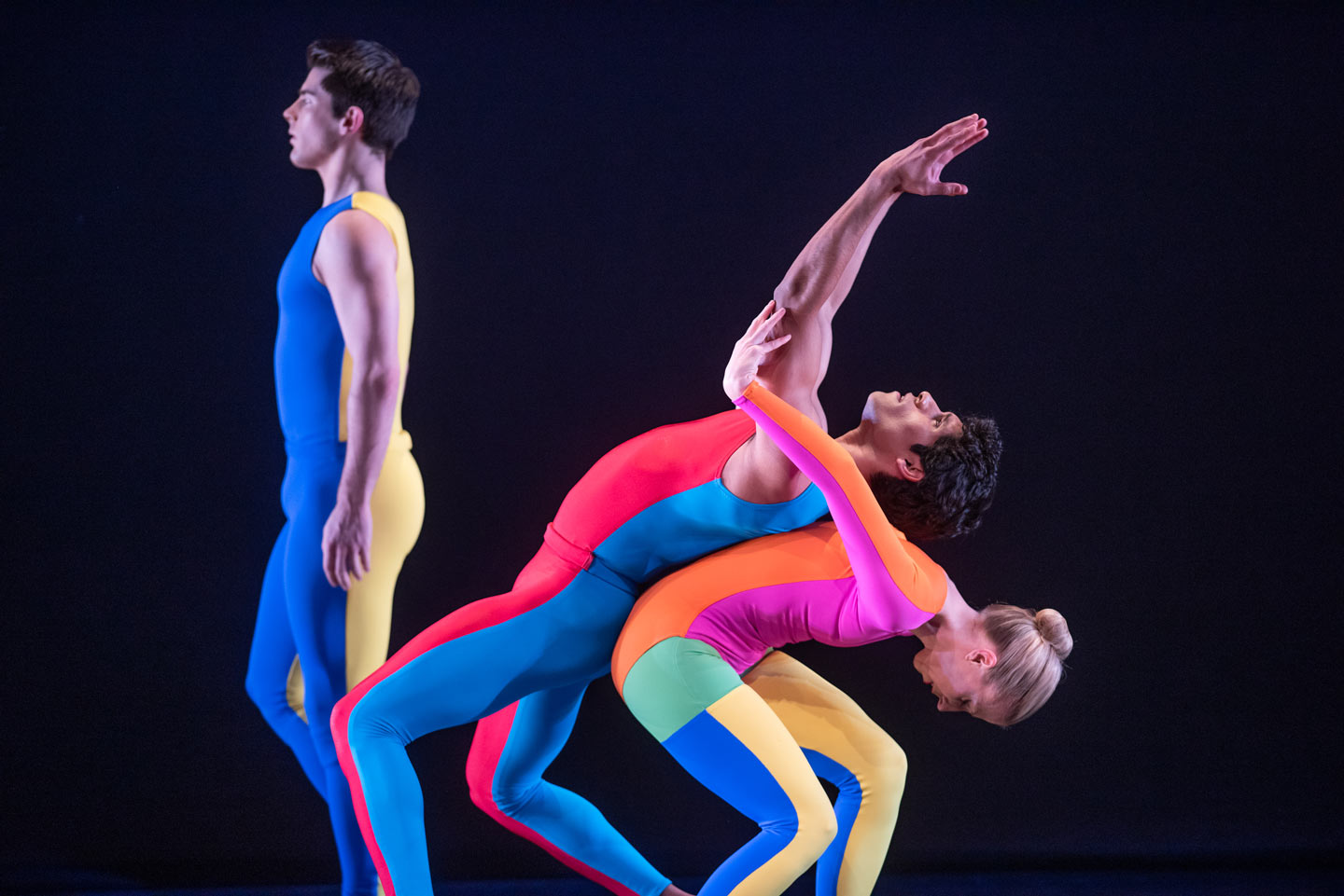 Three Taylor 2 Dance dancers with colorful outfits perform on stage at Lafayette College's Williams Center for the Arts.
