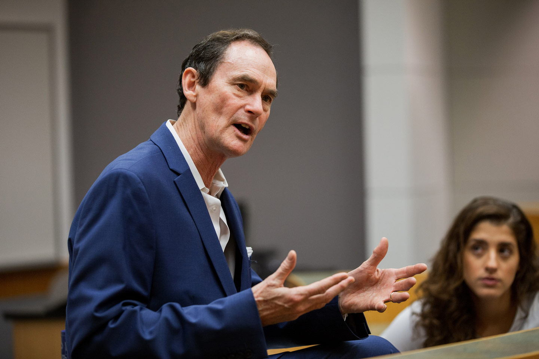 Professor Bob Mattison teaches in a classroom.