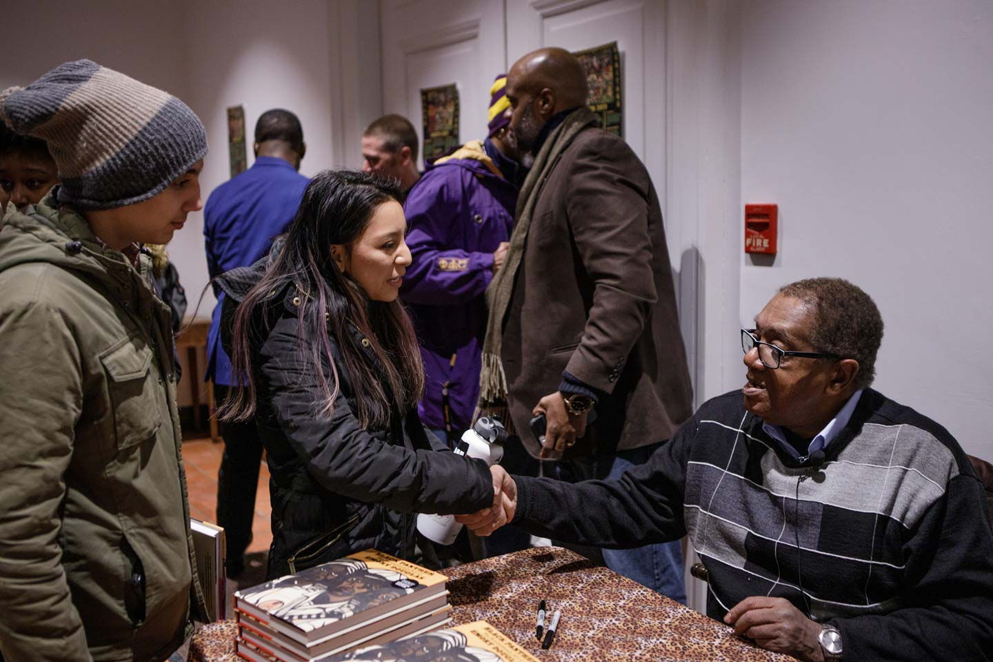Bobby Seale shakes a Lafayette College student's hand during a book signing after his lecture in Colton Chapel.