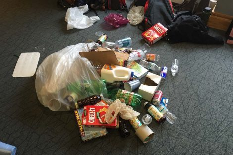 Recyclables spilling out of a bag.