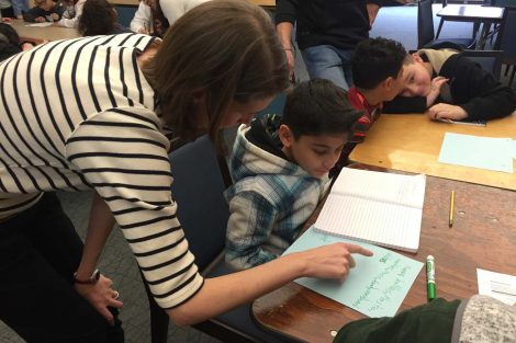 A Lafayette College student helps a Cheston Elementary School student with his work.