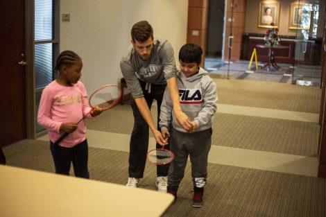 Lafayette student shows how to serve in badminton.