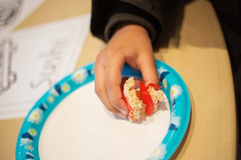 Second grader holds candy sushi he rolled.