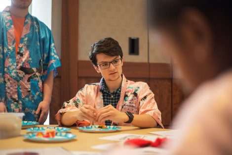 Lafayette student explains how to roll candy sushi.