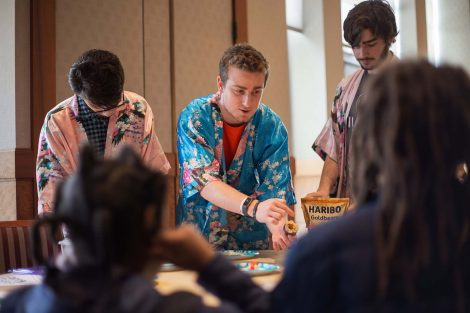 Lafayette student in silky gown show off how he rolled his sushi.