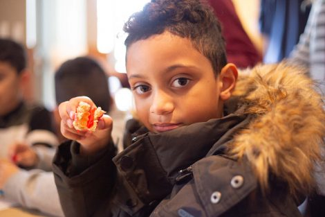 Young man holds up his candy sushi.