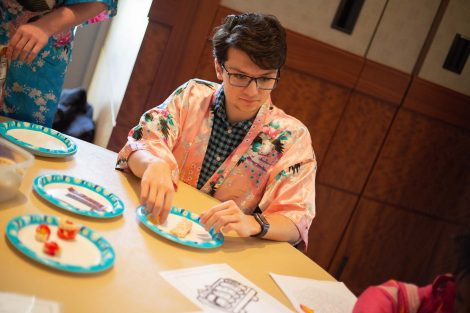 Lafayette student readies his plate to roll candy sushi.