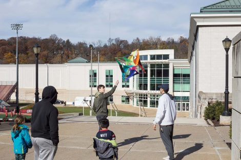 Lafayette student shows second graders how to fly a kite.