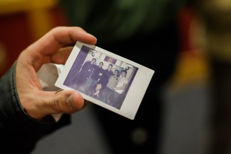 A student holds a Polaroid photo at the Lunar New Year celebration.