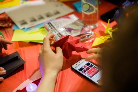 A student holds origami at the Lunar New Year celebration.